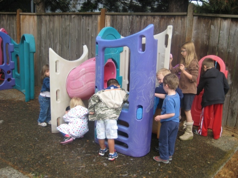 Must be summer, everyone is helping wash the play equipment and having a soapy good time.
