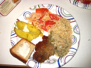Meatloaf, brown rice, green bean casserole, garden salad, baked potato with butter, and banana bread