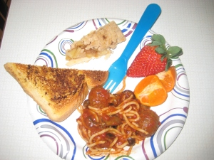 Homemade spaghetti w/ meatballs, mushrooms, carrots, celery, and black olives, cutie oranges, strawberries, garlic bread and apple pie