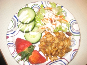 Chili-mac with whole wheat pasta, tomatoes, beans, and 7% ground beef, cucumbers, strawberries, and a garden salad with ranch dressing